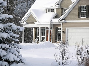 Modern new home covered in fresh winter snow.